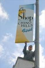 Shop Chino Hills First Banner being installed on a street light in Chino Hills.