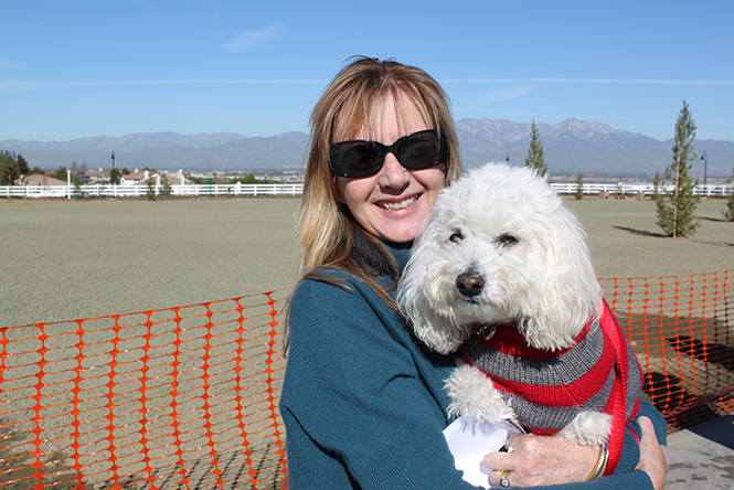 Photo of Dog Park Grand Opening guests Jean Gorgone and her dog.