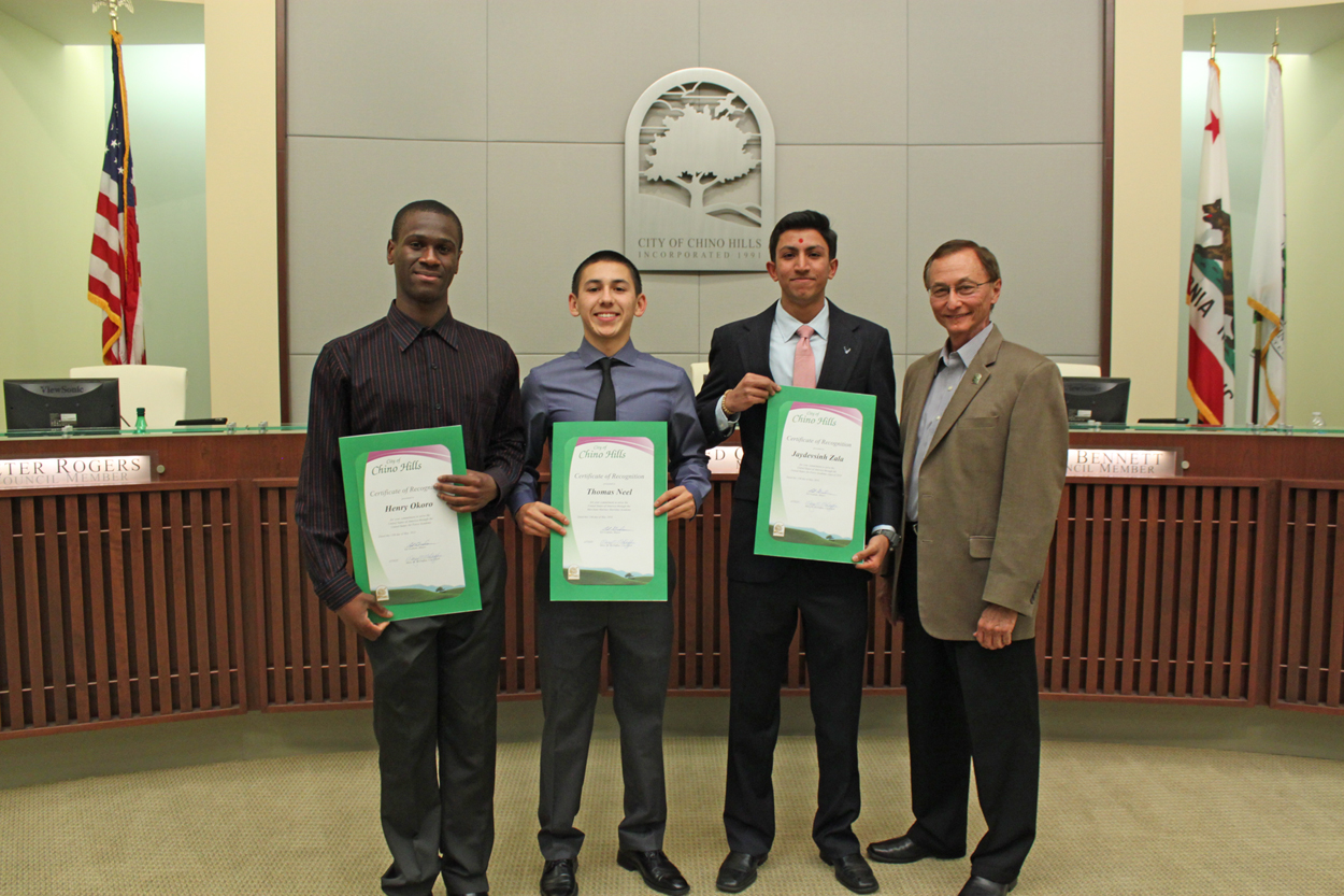 Photo of three students accepting Certificates of Recognition from Mayor Ed Graham
