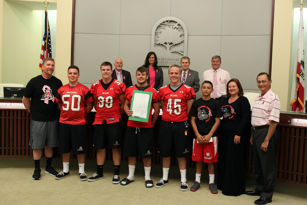 Ayala High School Football Team Members and the City Council are pictured