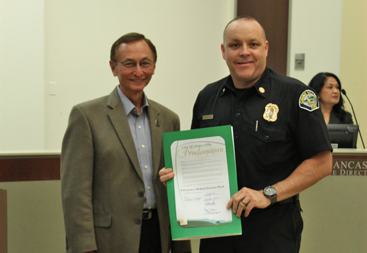 Photo of Interim Fire Chief accepting EMS Week Proclamation from Mayor Graham