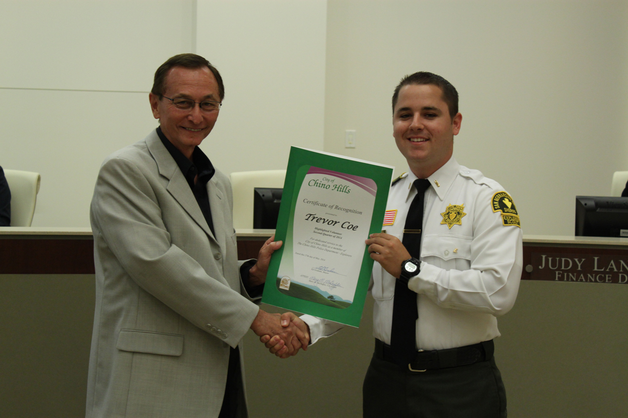 Photo of Trevor Coe, Highlighted Volunteer of the Quarter and Mayor Graham