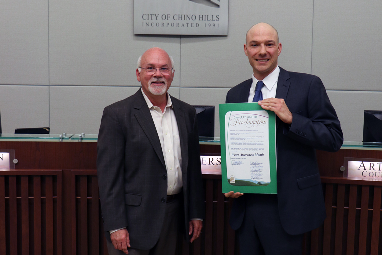 Photo of Water Efficiency Coordinator accepting proclamation naming Water Awareness Month