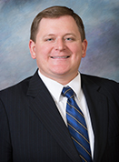 Portrait of Council Member Brian Johsz