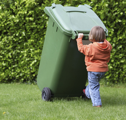 Child helping take out trash