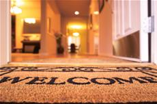 Welcome mat in front of a home.